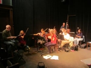 Musical director Gordon Stewart, left, working with orchestra members at the first rehearsal. Photo by A. Rooney