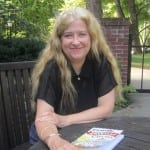 Author Jo Pitkin, pictured in the garden outside Butterfield Library. Photo by A. Rooney
