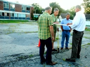 During an onsite visit last summer, Trustee Matt Francisco, left, and Mayor Seth Gallagher reviewed plans with developer Paul Guillaro and aide Matt Moran. Photo by L.S. Armstrong