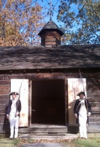 Costumed interpreters Sean Winchell and Matt Thorenz stand guard at the reconstructed Temple of Virtue at New Windsor Cantonment. Photo by M.A. Ebner