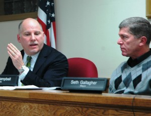 Trustee Matt Francisco, left, addresses the board, as Trustee Bruce Campbell listens. Photo by L.S. Armstrong