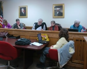 Before their vote, HDRB members finalize their resolution on demolition of the old hospital; left to right: Kathleen Foley, Peter Downey, Al Zgolinski, Carolyn Bachan, Marie Early. Photo by L.S. Armstrong