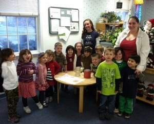 Larissa Nordone, left, and Jenn Weyant of The Nest with their hot chocolate-making pre-K students (Photo courtesy of Cecily Fluke)