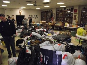 The Cold Spring Firehouse room, filled with donations, empties out as the trucks are filled.Photo by Linda Milne Speziale