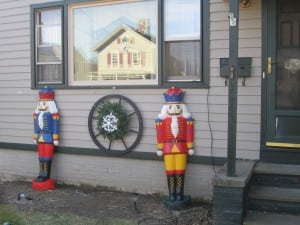 Two large nutcracker figures greet the children outside of the house. Photo by A. Rooney