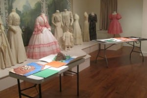 Saunders History Contest projects displayed with the museum's costume exhibit as a colorful backdrop (Photo by A. Rooney)