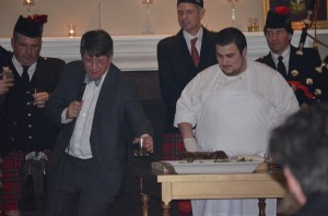 Nick Groombridge, second left, toasts the haggis on Burns Night, Jan. 26, as Hudson Highlands Pipe Band Chairman Mike Civita, Pipe Major Seth Gallagher, Chef Eric Gabrynowicz of Highlands Country Club, and piper Tony Sorrentino look on. Photo by J. Tao