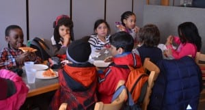 Community Roots second-graders enjoy pizza at Cold Spring Pizza on Jan. 17.Photo by Jeanne Tao