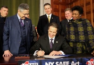 Governor Cuomo signs the NY SAFE Act on Jan. 15 (official photo).