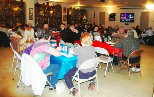 Supper tables fill the firehouse hall.Photo by L.S. Armstrong