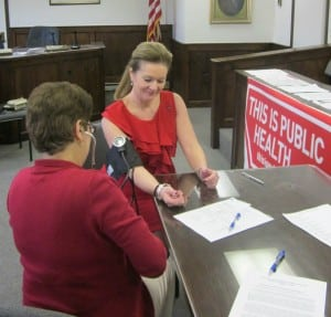 Putnam County Executive MaryEllen Odell supported Wear Red Day by dressing in red and having her blood pressure checked by public health nurse Jeanette Baldanza from the Putnam County Department of Health. Photo courtesy of Putnam DOH