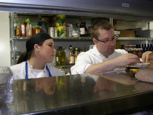 Afternoon garde manger Alessandra Benedetto and Chef Brandon Collins discuss preparations for roulade of guinea hen.