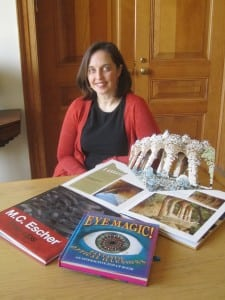 Courtney Watson McCarthy with her books, including a page opened from her Gaudi Pop-Ups. Photo by A. Rooney