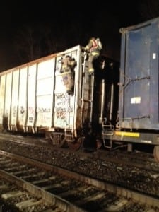 CSFC firefighters scale the box car that caught fire just south of the Cold Spring train platform.