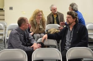 Mayoral candidate Ralph Falloon speaks with members of the audience after the March 13 candidates forum. Photo by Jeanne Tao