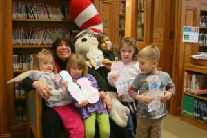 A group of young library patrons celebrated Dr. Seuss' birthday last week at the Desmond-Fish Library with new youth services librarian Lucille Merry and the Cat in the Hat. Photo courtesy of Karen Thompson/Desmond-Fish Library