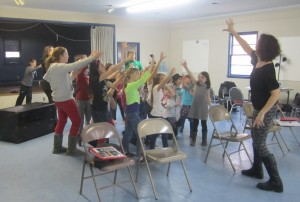Choreographer Christine Brooks Bokhour working with the Musical Mystery Tour kids
