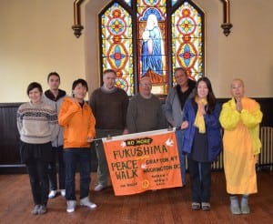 Walkers on the Peace Pilgrimage for a Nuclear-Free Future, led by Japanese Buddhist nun Yasuda Jun, far right, at St. Mary's Episcopal Church in Cold Spring (Photo by J. Tao)