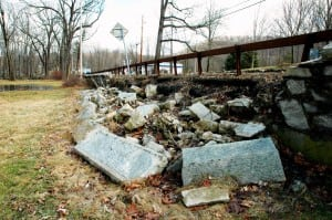 A stretch of wall tumbles into the yard at St. Philip's church. Photo by L.S. Armstrong