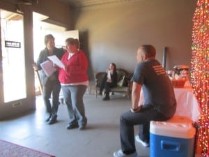 Chris Edwards, right, watches a group of teachers working on a scene from 'Othello.'