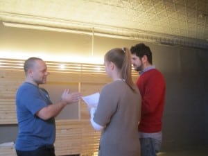 Chris Edwards, left, works with Rachel Ashendorf and Laurence Berkowitz on a scene from 'Othello.'