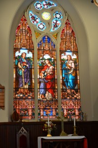The main window at the United Methodist Church of South Highland depicts Faith, Hope and Charity.