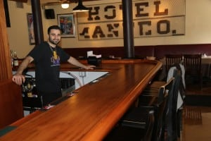 Owner Frank Ciafardini behind the newly refurbished bar at Whistling Willie's American Grill. Photo by Maggie Benmour