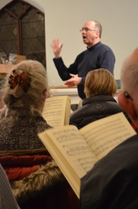 Woody Entrekin directs the St. Philip's choir in rehearsal. Photo by J. Tao