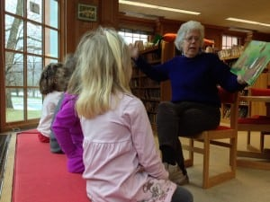 Polly Townsend reads to children during story hour at the Desmond-Fish Library.