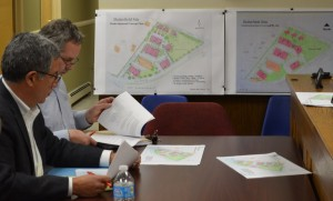 Paul Guillaro, left, and Matt Moran of Butterfield Realty prepare to present the new concept plan for the Butterfield development, far right. Photo by J. Tao