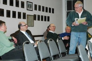 At the Town Board meeting, GVFC members Betsy Calhoun, far left, and Steve Rosario, left, confront Joe Regele, far right, a long-time critic of  GVFC financial management. Photo by L.S. Armstrong