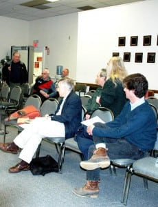 Roger Chirico, standing, upper left, answers questions from audience members at a Town Board discussion on dirt roads in March. Photo by L.S. Armstrong