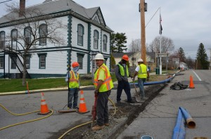 MSI workers Jason Chambers, left, Sergio Leon, Dave Fulford and Orlando Mejia install a temporary water line near the Philipstown Town Hall on April 10.