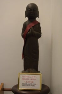 A statue greets visitors to the Peace Mountain Buddhist Hermitage.