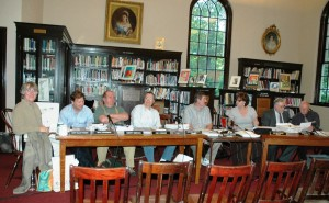 Philipstown Planning Board members convene at the Butterfield Library; from left: Mary Ellen Finger, Neal Zuckerman, Kerry Meehan, Kim Conner, and Chairman Mike Leonard, with Ann Gallagher, secretary; Stephen Gaba, attorney; and Ron Gainer, engineer.