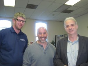 Project manager Conor Kays, Hudson Valley Wind Energy owner Doug Passeri and homeowner/applicant James Gleick