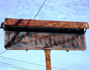 The sign stood alone and neglected before its restoration. Photo courtesy Barbara and Thomas Scuccimarra