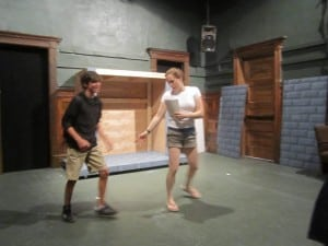 Director and choreographer Katie Bissinger works with cast member Jeremy Roffman.