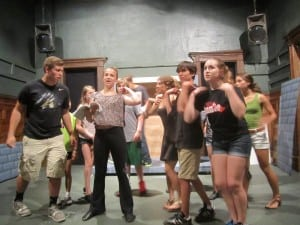 The cast rehearsing one of the musical numbers.