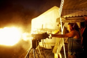 Story Rush, a kindergarten teacher from Greenwood, Ark., fires an M1919 Browning .30 caliber machine gun on the first night of OFASTS (Oklahoma Full Auto Shoot and Trade Show).    Photo by Peter Muller, courtesy of Fovea Exhibitions