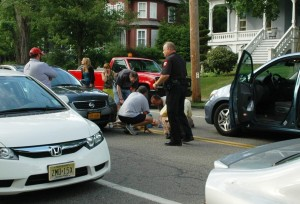 Good Samaritans, aiding the woman struck, and Cold Spring Police Officer Bill Bujarski were among those responding to the Morris Avenue accident. Photo by L.S. Armstrong