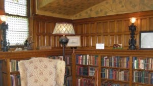 Fine woodwork, stained glass, and a collection of many first edition books inspire in the Wilderstein library.