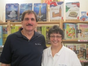 The Gift Hut's proprietors, Jim and Fran Farnorotto, in front of their many puzzles.