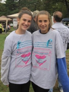 Wearingblueribbonsrecognizingovariancancer,twoyoungwalkerssportSupportConnectionT-shirtsatthe2012Support-a-Walk.