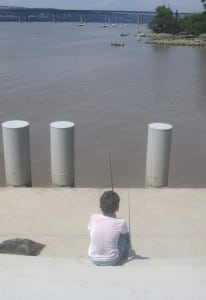 Oliver, age 8, keeps a watchful eye on his fishing line.