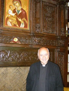 Father Constantine L. Sitaras, pictured here in his office, is the executive director at Saint Basil Academy.