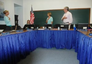 The Pledge of Allegiance heads the agenda at the GUFS meeting, with Superintendent Gloria Colucci, center left, and Board President Raymond O'Rourke, center right, joining in, alongside Board Member Theresa Orlandi, left, and a young flag-bearer. Photo by L.S. Armstrong