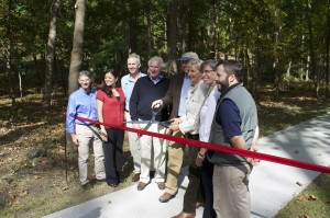 Scenic Hudson board members and staff officially open the West Point Foundry Preserve.  Holding the scissors, Fred Rich, board chair and Rita Shaheen, director of parks. Photo by K.E. Foley