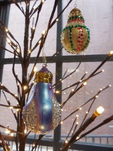 Maureen Winzig presents her hand-painted light bulb decorations.