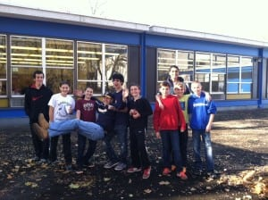 St. Philip's Cross Trainer youth group engages young people in community service.